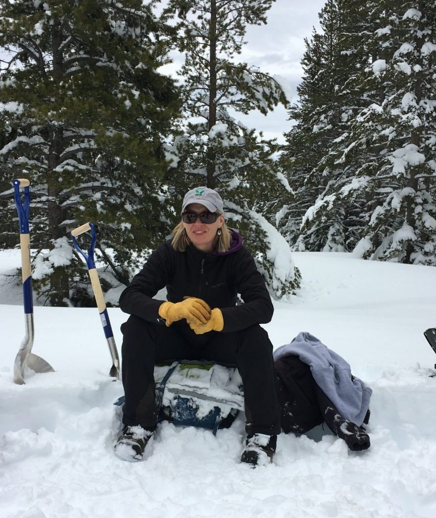 Renee Seidler, Jackson Hole Wildlife Foundation Executive Director takes a rest during winter wildlife research